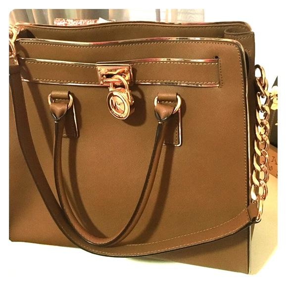 5d5166d36639 Buy michael kors hamilton purse gold   OFF44% Discounted