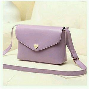 Lavender faux leather cross body bag