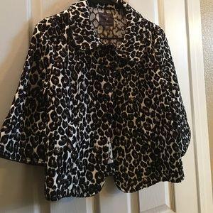 Leopard print cape coat.