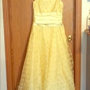 Yellow polka dotted dress.