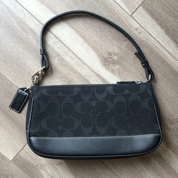 Small black fabric and leather coach purse