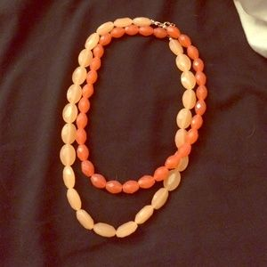 Beaded necklace in coral colors