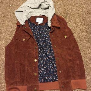 Rust colored Corduroy vest with grey Tshirt hood