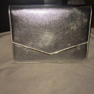 Handbags - Clutch.