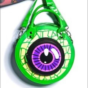 Dollskill Bags - ISO. DOLLSKILL GREEN EYE BAG.