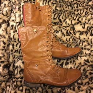 Brown combat boots. Cheetah print inside.
