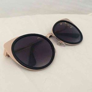 Black with gold frame sunglasses