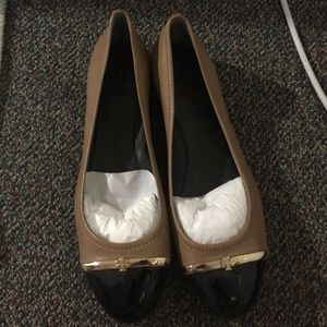 Rare Tory Burch flats... Stuffing inserted in pic