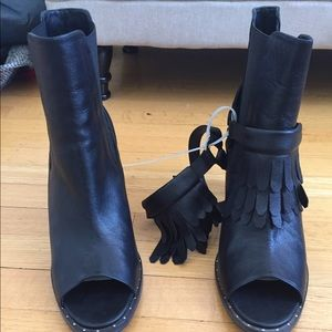 Freda Salvador black leather heeled boots.