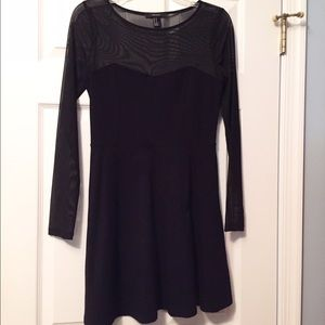 Black skater dress with sheer sleeves and neckline