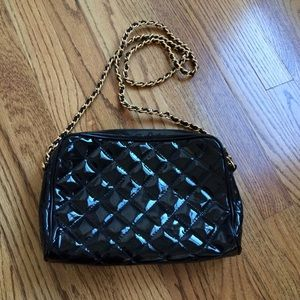Quilted black patent bag with gold chain