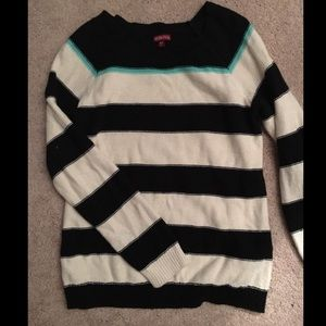 Black and white striped sweater.