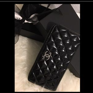 CHANEL Handbags - CHANEL Patent Leather Quilted CC Zip Wallet