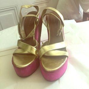 Gold platform sandals with pink suede type heel.