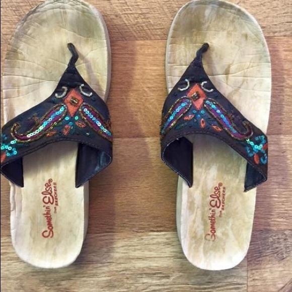 da7c8782572d Somethin Else by Skechers brown beaded flip flops.  M 56d7a0c378b31cb159003200