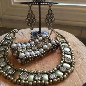 Sparkly crystal and brass toned jewelry.