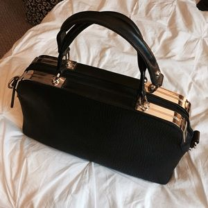 Charming Charlie Bags - Black and gold hand bag
