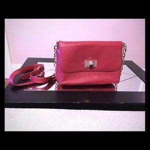 Red cross body vegan leather bag