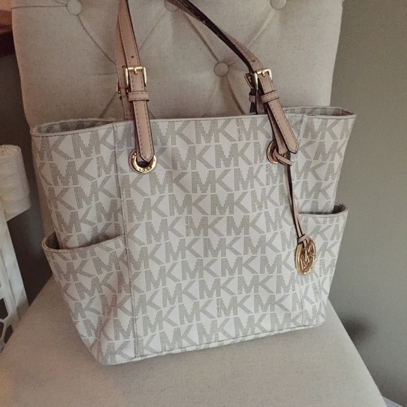 34a178463090 MK Jet Set Vanilla Logo Tote in PVC. M_56d9c5c1620ff75d700048d7. Other Bags  you may like. Michael Kors tote bag