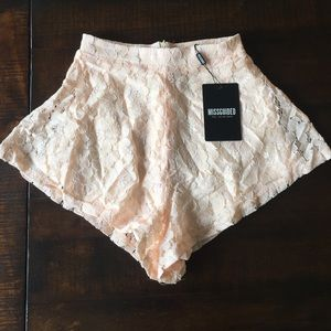 Raised hem lace shorts nude by Missguided