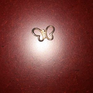 Rose gold butterfly pendant- chain not included.