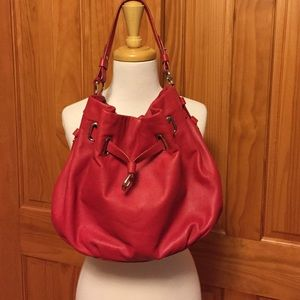 Cole Haan red leather handbag.