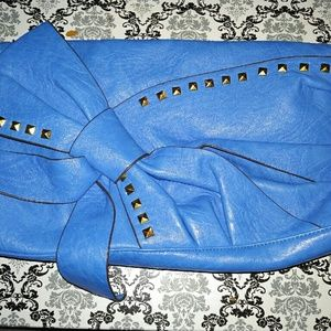 Oversized blue bow clutch