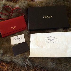41% off Prada Handbags - Prada 1M1437 Red leather clutch wallet w ...