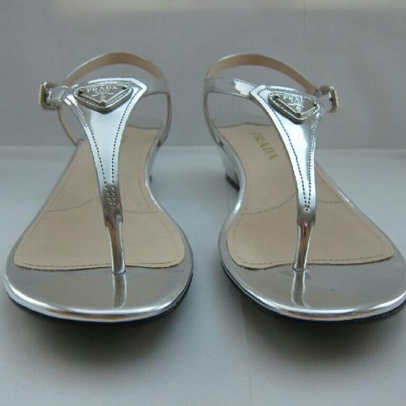 568ea0f256ccbd Prada Metallic Silver Leather Logo Thong Sandals. M 56de3a487f0a05e91600ae3c