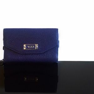 Tumi Handbags - • Tumi • Leather Wallet