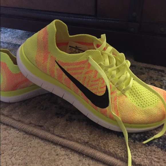 e684af89b65bbf Neon Yellow Nike Flyknit Shoes Size 8.5. M 56e0145a99086ad27a038f39