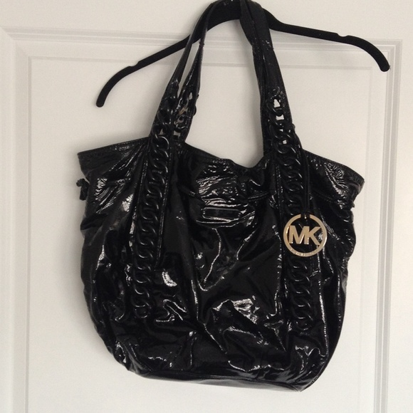 a8ee3bc41d1e FLASH SALE Michael Kors black patent handbag. M_56e078e6680278180c040dd6