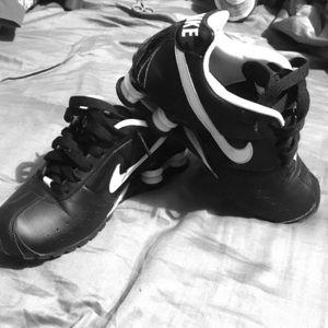 Black and white Nike Shocks