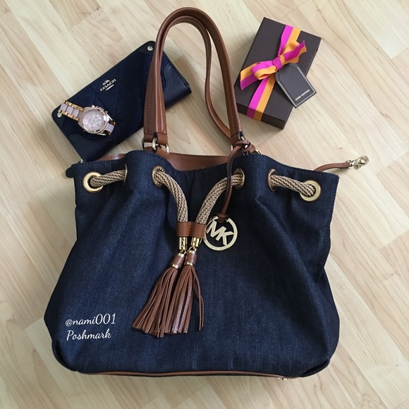 7e55cf8dbf2211 Michael Kors Marina Denim Drawstring Tote Purse.  M_56e0db7778b31ce77a01206b. Other Bags ...