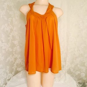 sleeveless top w/button-down back. FINAL CLEARANCE