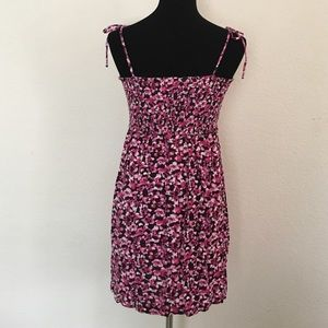 Maternity dress from Flirty Pink elastic around the waist. Fits like non maternity dress other than it's longer in the front to accommodate a belly. Super cute print!