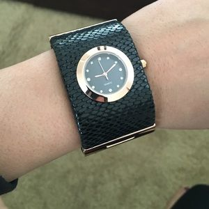 Black and Rose gold watch.