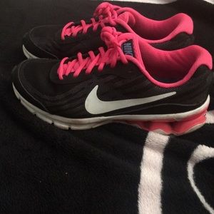 Black pink and white nike sneakers