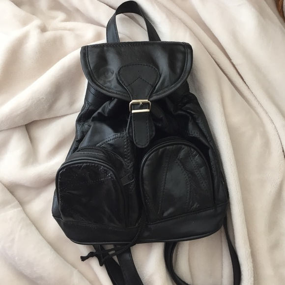 48% off UNIF Handbags - Cute little black leather backpack from ...