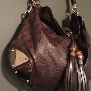 Gucci Bags - Brown leather Gucci monogram bag. ccd7b1cca