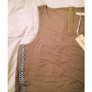 Taupe color with tribal trim tank