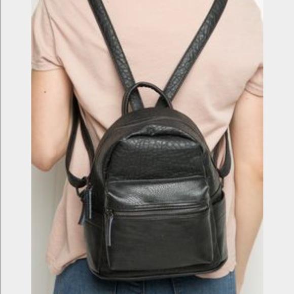 29326ea005 Brandy Melville Handbags - Mini Black Faux leather Backpack