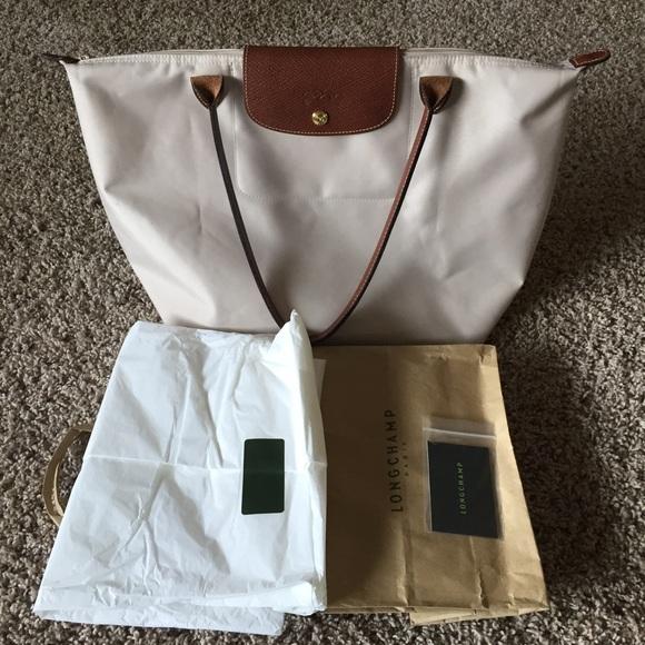 Longchamp Handbags - Authentic Longchamp Le Pilage in cream color af2045b5a75e5