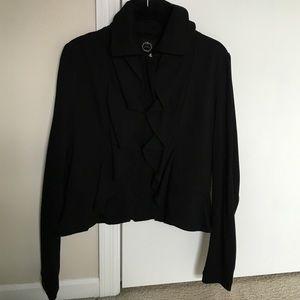 Black fashion jacket with ruffle detail.