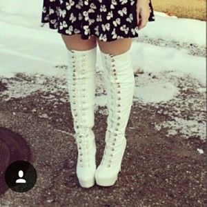 Thigh high white boots.