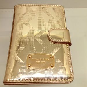 abbb359ade8dd MK Gold Metallic Wallet