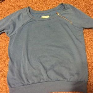 Blue sweatshirt with zipper on left shoulder