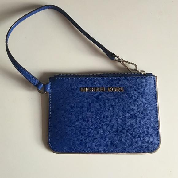 c57a5d7e08c5 Authentic Michael Kors small clutch in Royal Blue.  M_56eb1e0e7f0a052b98015c84