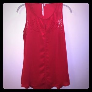 Red tank, cut out design on front