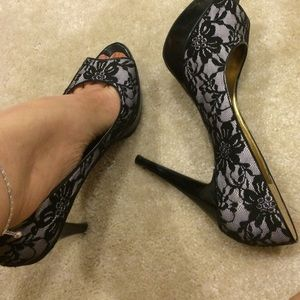 Guess high-heeled vintage lace patterned shoes.